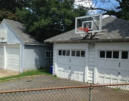 this picture demonstrates a good contrast between a roof and wall mounted basketball goal