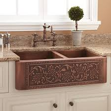 cool brown double copper farmhouse sink with white glass window and granite countertops in traditional kitchen