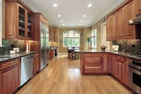 Cherry wood features closed wood grain and natural colors that range from white to light brown with a red hue. Traditional Medium Wood Cherry Kitchen Cabinets 94 Kitchen Design Ideas Org Wood Kitchen Cherry Cabinets Kitchen Best Flooring For Kitchen