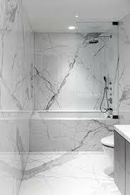 marble bathrooms. it seems like the carrara marble slabs always look better than tiles. bathrooms