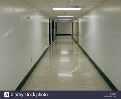 Empty hallway in hospital leading to emergency room