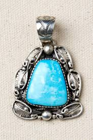 navajo sterling silver and turquoise feather pendant