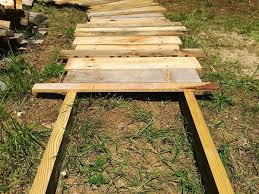 create this simple s wood walkway in your yard its a beautiful wood path