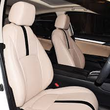 toyota beige with black seat cover upholstering