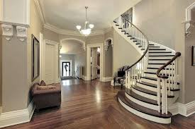 grey and white theme entryway with classic stairs