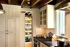 beautiful kitchen with rustic exposed wood beam ceiling as well as pocket door leading to walk in pantry