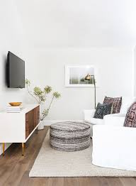 modern minimal lounge lighting. Small TV Room With White Sofa, Ottoman, Indoor Plant, And Modern Floor Lamp P Minimal Lounge Lighting