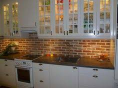 Small Galley Kitchen Makeover with brick backsplash