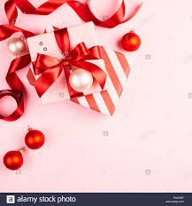 Gifts Background Christmas Gifts With Red Ribbon On Pink Background With