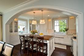 lighting over a kitchen island. Example Of A Classic Kitchen Design In Boston With Glass-front Cabinets, Farmhouse Lighting Over Island E