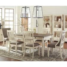 extendable dining room table by signature design by ashley. signature design by ashley bolanburg 7-piece dining set with host chairs in antique white extendable room table c