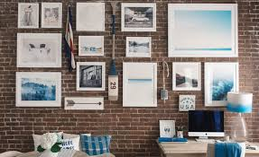 gallery wall on exposed brick walls