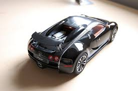 Black carbon & black matt with tangerine hide. Review Autoart Bugatti Eb Veyron 16 4 Sang Noir Diecastsociety Com
