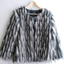 my latest and most exciting sewing project a faux fur coat it s easy to make and it s warm and it s glamorous oh and fluffy it is very very fluffy