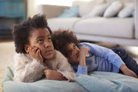 black kids watching tv. brother and sister lying on floor watching tv together black kids tv ?