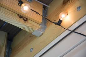 globe string lights under a deck