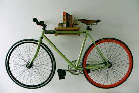 Bike hanger for apartment Diy Bike Shelf Systems Can Easily Be Found On Etsycom They Can Range From Sleek To Crafty To Rustic All Play On The Idea Of The Shelf And Are Great Livin In The Bike Lane Livin In The Bike Lane Apartment Bike Storage Solutions