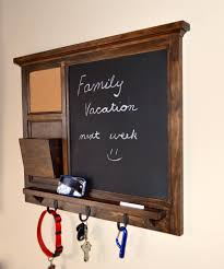 interior mesmerizing chalkboard key holder design that created with three holder options and wooden frame