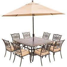 traditions 9 piece aluminum outdoor dining set with square cast top table with natural