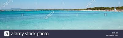 beautiful beach with white sand and turquoise sea landscape format es trenc beach in palma de mallorca spain