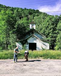 appalachian culture appalachian voices photographer brady darragh and activist chuck nelson stand outside the abandoned union hall in lindytown