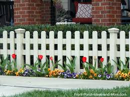 White fence ideas Horizontal Picket Fence Lined With Tulips And Pansies In The Spring Front Porch Ideas Picket Fence Ideas For Instant Curb Appeal