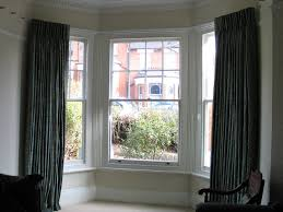 French cloque work in silk, interlined and pinch pleated curtains, corded  steel bay window