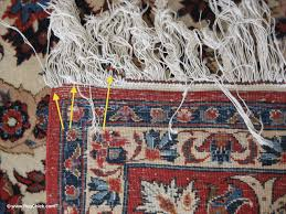 the decorative braid is sliding away from this persian rug the fringe is unraveling and