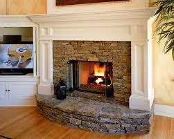 stacked stone fireplace spaces traditional with none image by witt construction