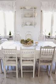 white cote with lovely mismatched chairs