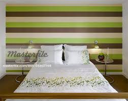 Striped lime green and brown wallpaper in private House, Worsley, Salford,  Greater Manchester, England, UK. Architects: Stephenson Bell - Stock Photo