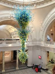 in the main entrance is an amazing glass chandelier that could be called an art installation as well it looks a little like medusa the v a