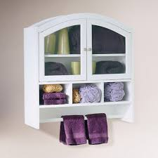 white color wood wall mounted bathroom storage cabinet with towel holders and glass door with towel shelves ideas