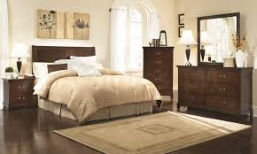 furniture dark brown wooden bedroom dresser added by cream bedding set on the bed and