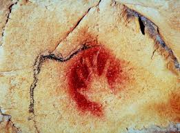 an ice age artist most likely created this image in chauvet cave by spitting red pigment over a hand pressed against the rock