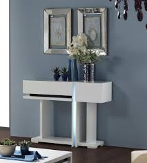 small contemporary modern white console table with storage on dark