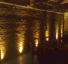lighting for walls. interesting walls brick wall lit by several uplighters inside lighting for walls
