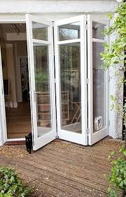 accordion glass doors with screen. this style patio door (with the cat flap and cat) accordion glass doors with screen