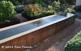 steel walls and soft gr in travel influenced mirador garden concrete block raised beds