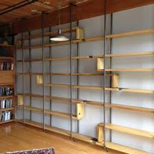 metal book shelves.  Metal Wood And Steel Floating Book Shelves By Joshua Ingold Throughout Metal