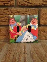 alice and the tweedles light switch cover the photo came from a disney alice in