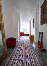 Hallway with striped carpet runner #stripes #modern urban living. Styled by  Diana Civil