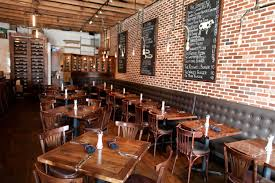 industrial restaurant furniture. i like the industrial light fixtures brick wall and chalkboards a relatively neutral color palette leaves options for artwork unexpected pops of restaurant furniture