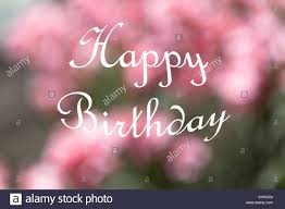 happy birthday pink and green pastel colored defocused pink and green floral background with large