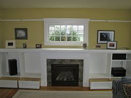 fireplace walls ideas white traditional fireplace mantel with yellow background walls