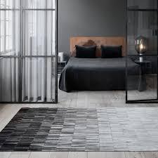 fade rug by linie design grey striped leather