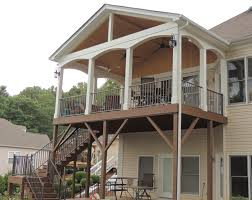 Covered porch with Trex Transcends, Reveal railing and T&G ceiling.