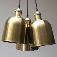 trio of brass pendant lights