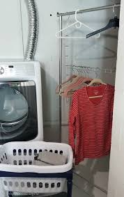plastic garment rack painted with metallic spray paint for laundry room makeover