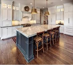 above this stunning kitchen features a carrara marble island with 3 inch mitered edge and nero orion on the perimeter countertops